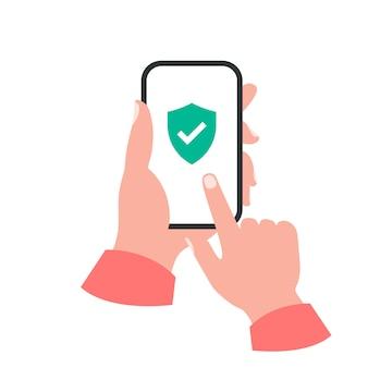 Smartphone em seu conceito de mão. marca de verificação do escudo Vetor Premium