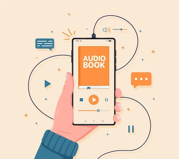 Smartphone na mão com interface de app de livro de áudio na tela