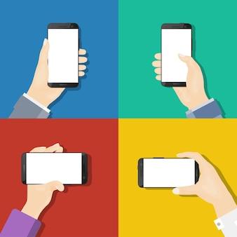 Smartphones nas mãos. design plano.