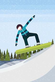 Snowboarder homem descendo a montanha