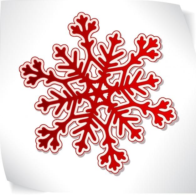Snowflacke de papel vermelho sobre adesivo em branco