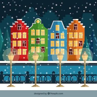 Snowy cidade com casas coloridas ilustração
