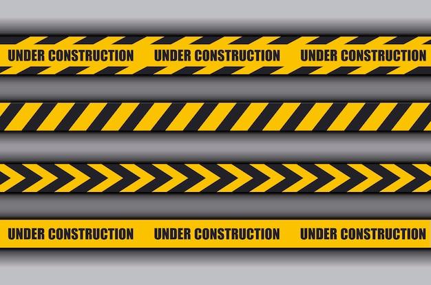 Sob a fita de advertência de construção