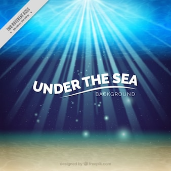 Sob o mar com fundo sunburst