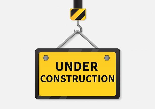 Sob o sinal da construção.
