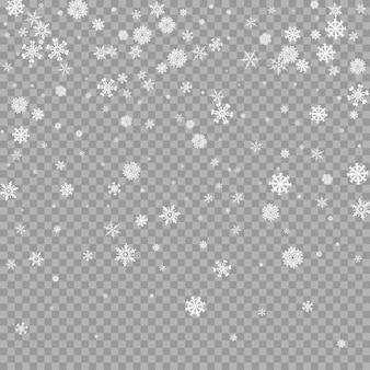Sobreposição de neve branca caindo realista em fundo transparente camada de tempestade de flocos de neve