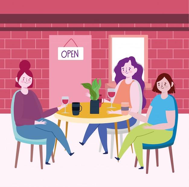 Social distanciando restaurante ou um café, mulheres jovens com copos de café e vinho na mesa