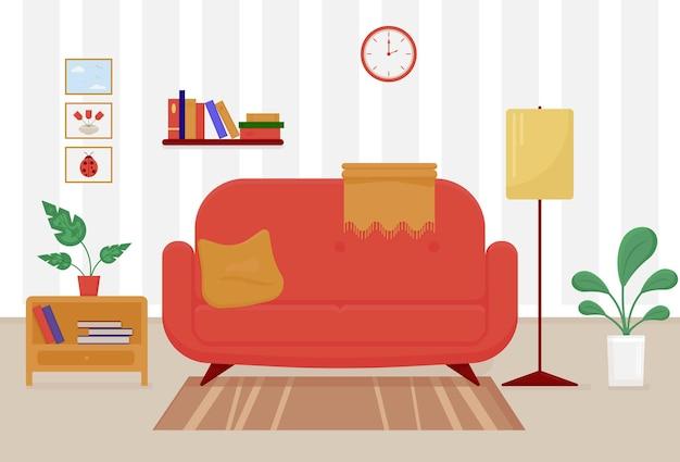 Sofá vermelho com travesseiro e cobertor é colocado na sala de estar com plantas de carpete e abajur