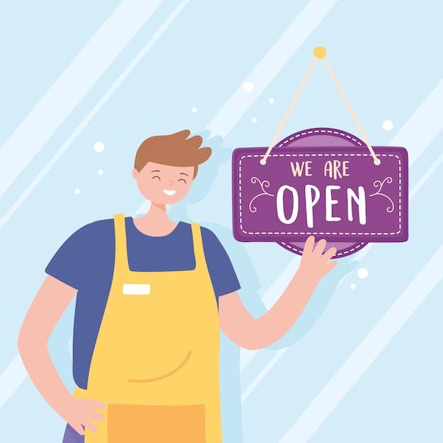Somos sinal aberto e jovem funcionário com avental