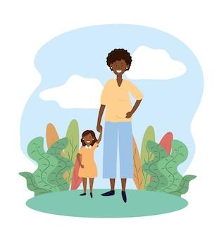 Sorria mulher mãe com sua filha e plantas