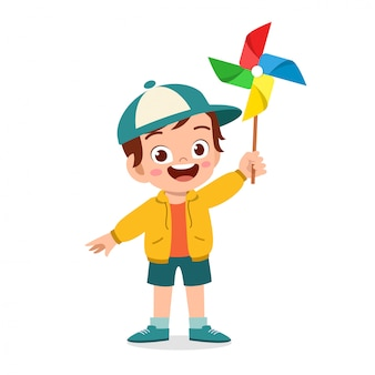 Sorriso bonito garoto garoto feliz segurando o brinquedo