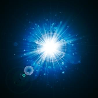 Star explodiu com brilhos. efeito de luz. textura de glitter azul.
