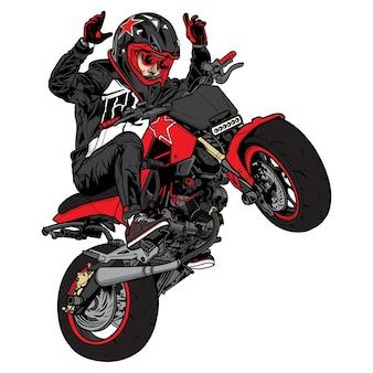 Stunt bike andando de motocicleta com a roda levantada