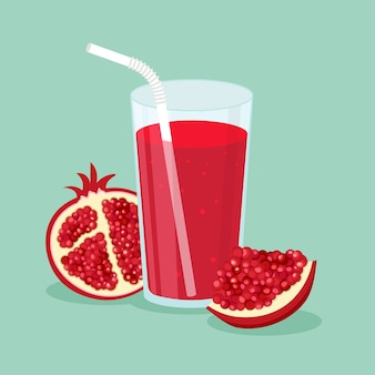 Suco natural de romã em um copo e fruta de romã