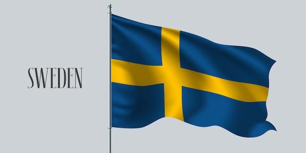 Suécia acenando uma bandeira no mastro da bandeira.
