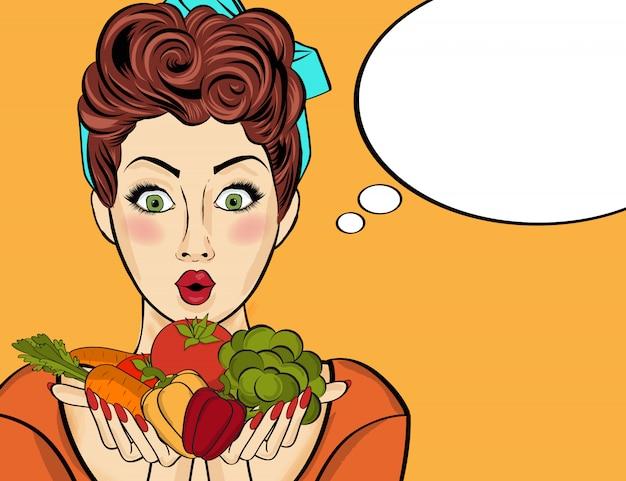 Surpreendeu a arte pop mulher que contém legumes nas mãos dela
