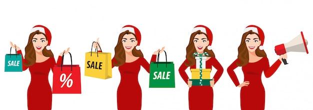 Surpresa natal mulher bonita no chapéu de papai noel com sacola de compras, caixa de presente e megafone