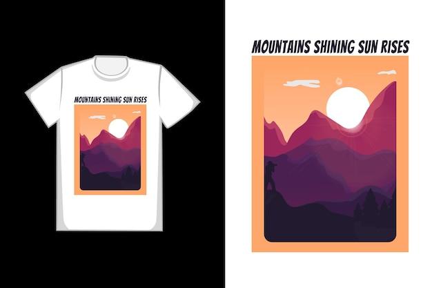 T-shirt design montanhas brilhando sol nasce