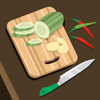 Tábua de cortar com pepino, pimenta e faca