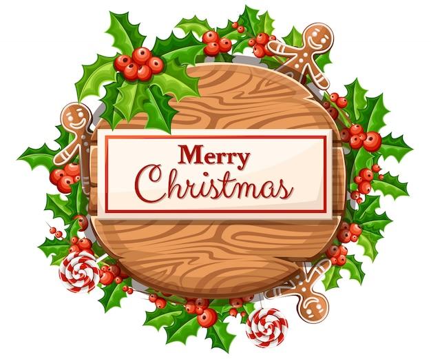 Tábua de natal de madeira com conjunto de decoração de natal e a inscrição com ilustração de feliz natal em fundo branco.