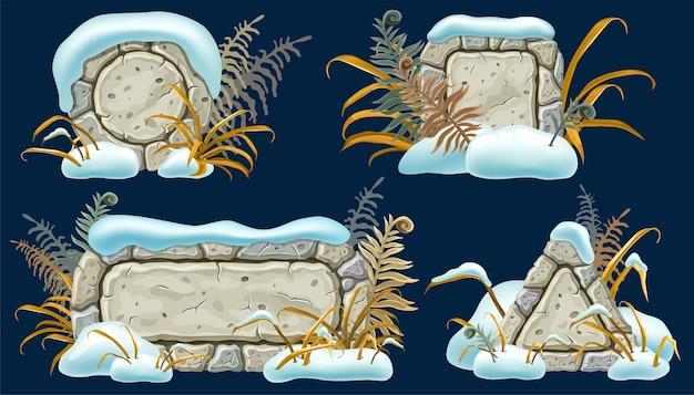 Tábuas de pedra com montes de neve, grama, samambaia.