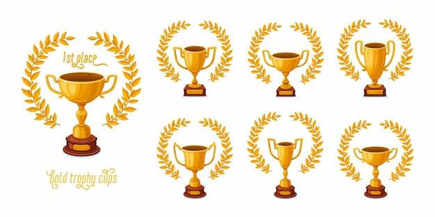 Taças de troféu de ouro com coroas de louros