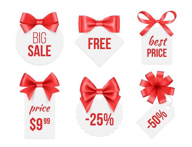 Tags com fitas. emblemas promocionais com laços de seda de cetim vermelhos e dourados, anunciando o modelo para fotos de vendas de grandes comemorações