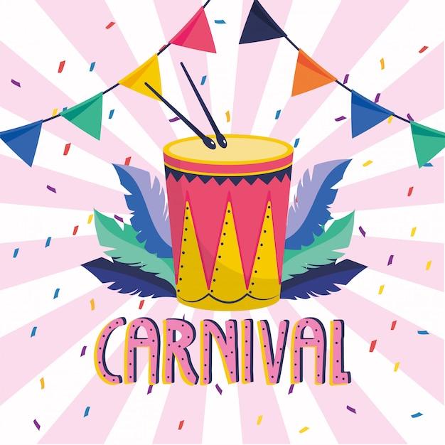 Tambor com penas e festa ao carnaval