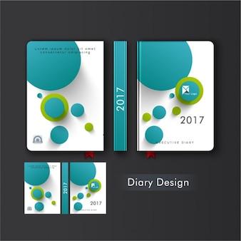 Tampa do diário com círculos azuis e verdes