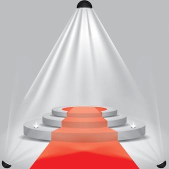 Tapete vermelho ao palco do pódio com holofotes