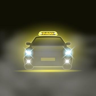 Táxi com cantor especial no teto e faróis na estrada noturna