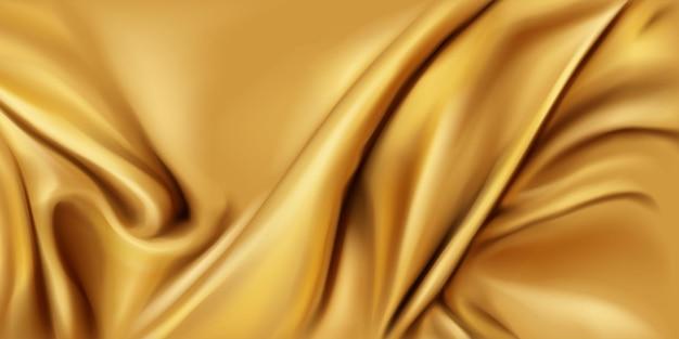Tecido de seda dourada dobrado