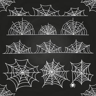 Teia de aranha branca no pano de fundo de quadro de giz. bordas e decoração de halloween