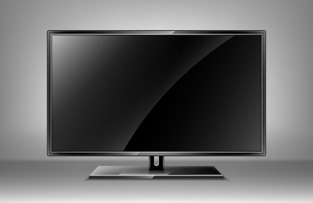Tela de tv plana vazia em pé contra uma parede branca.