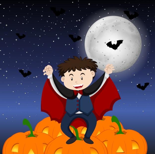 Tema de halloween com menino em fantasia de vampiro
