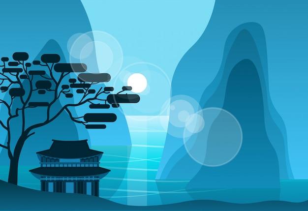 Templo asiático nas montanhas na noite na paisagem do pagode da silhueta do fundo