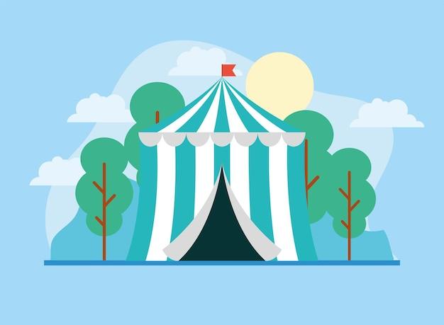 Tenda de circo e bandeira com paisagem de fundo