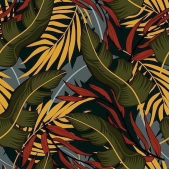 Tendência abstrata padrão sem emenda com folhas tropicais coloridas e plantas em fundo azul