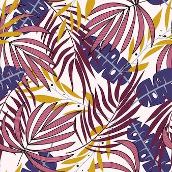 Tendência abstrata padrão sem emenda com folhas tropicais coloridas e plantas sobre um fundo delicado