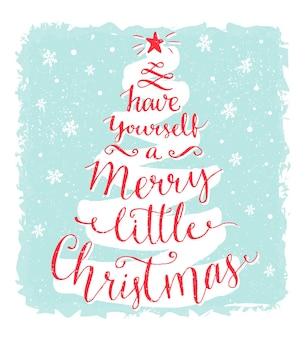 Tenha um pequeno cartão de feliz natal com caligrafia em forma de árvore de natal