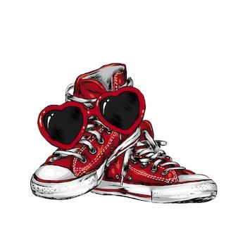 Tênis e óculos em forma de coração