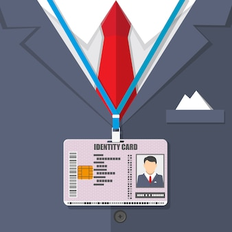 Terno de homem com gravata vermelha e crachá de identificação.