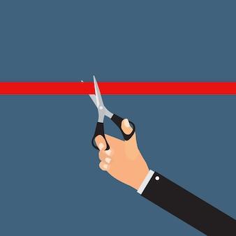 Tesoura de mão cortando a fita vermelha. conceito de inauguração
