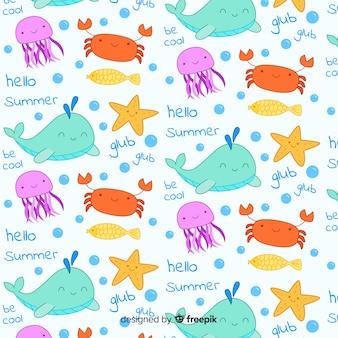 Teste padrão colorido dos animais e das palavras de mar do doodle