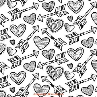 Teste padrão com esboços de setas e corações