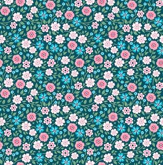 Teste padrão floral fofo nas pequenas flores coloridas. textura perfeita. fundo verde.