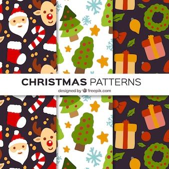 Testes padrões do natal de elementos pintados à mão
