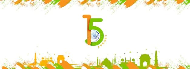 Texto de 15 de agosto com roda de ashoka, efeito de pincel verde e laranja famoso monumento da índia