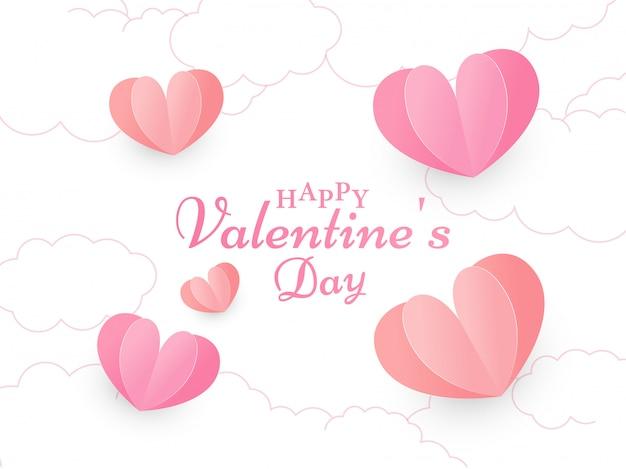 Texto de feliz dia dos namorados de caligrafia na nuvem branca decorada com corações de corte de papel vermelho e rosa.