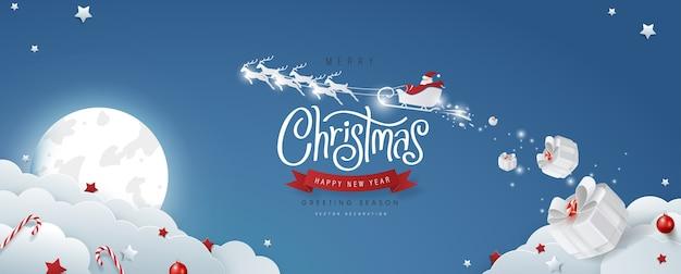 Texto de feliz natal com letras caligráficas e papai noel no céu
